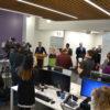 Cladio Rigatto speaks at podium in new centre.